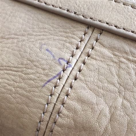 how to remove pen marks from a leather bag