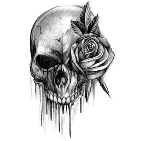 rose tattoo with skull and skull design