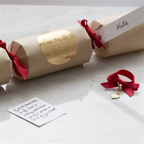 personalised luxury christmas cracker with silver gift by