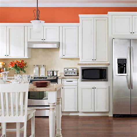 find the kitchen color scheme orange walls