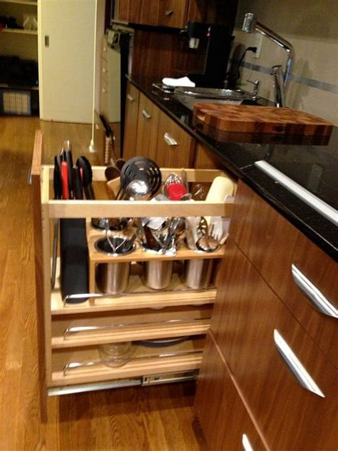 Vertical utensil storage in pullout   * Kitchen July