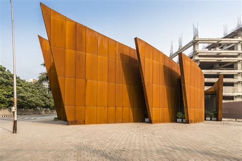 curvaceous corten steel office building beats the heat with solar savvy design inhabitat