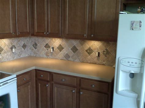 tumbled marble backsplash with u