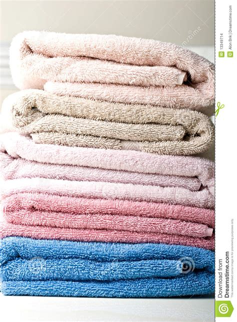 color stack pastel color stack of towels on a table stock images