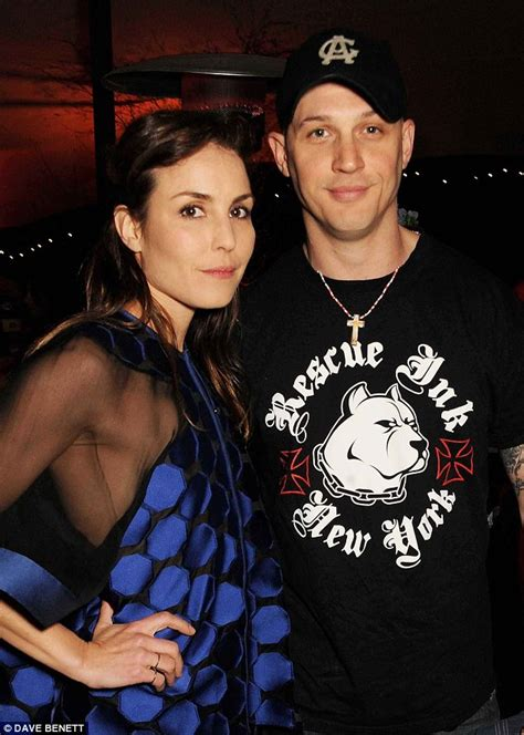 noomi rapace and tom hardy cuddle up to cute puppy while noomi rapace cuddles up to her animal rescue co star tom