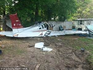 backyard airplane crashed pilot hits porch but successfully lands airplane