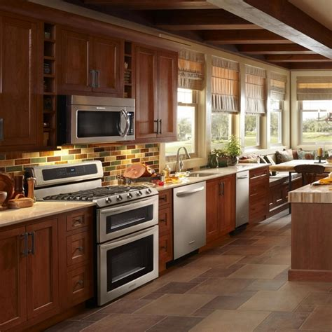 how to finish kitchen cabinets restaining cabinets give a new to the dated kitchen