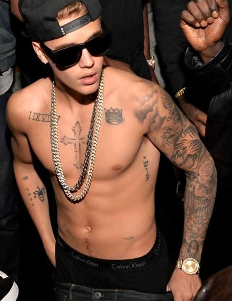 justin bieber first tattoo a quot top 5 quot look at justin bieber s best worst tattoos