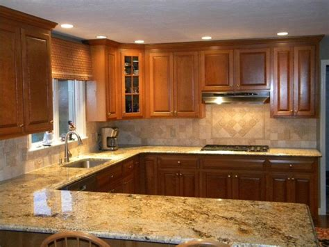 granite and backsplash combinations namibian gold granite countertops w tumble marble