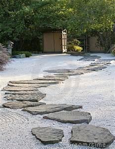 a japanese rock garden with a path garden path