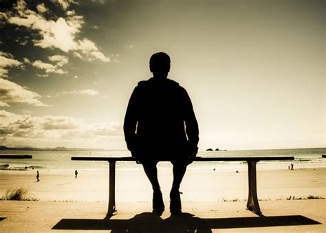 man sitting on bench academic s prospects for promotion mostly depend on