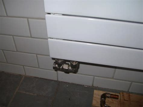 installing runtal radiators which pipe in basement supplies which radiator