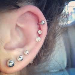 tripple lobe and cartilage ear piercings