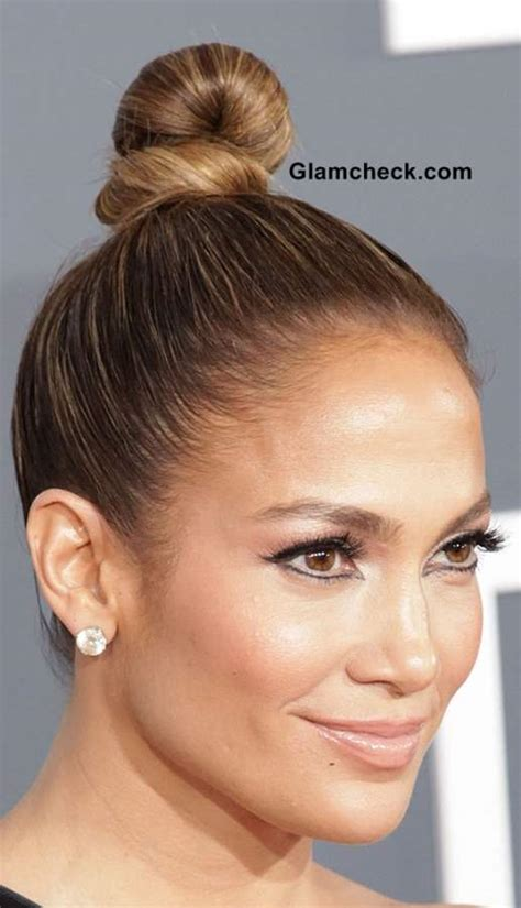jlo hairstyles 2013 jennifer lopez top knotted bun hairstyle 2013 top bun