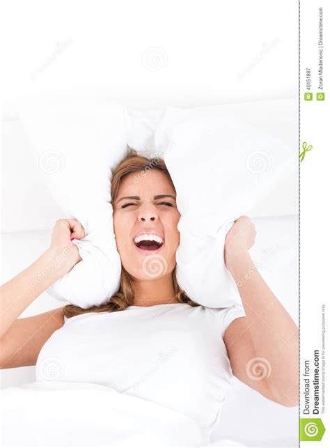 how to make a girl scream in bed beautiful woman is lying in bed and covering her ears with