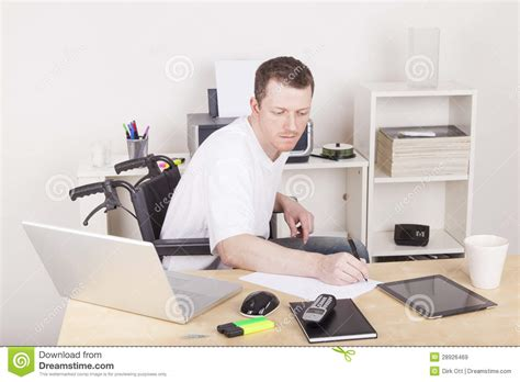 computer desk for disabled disabled man in wheelchair at home office royalty free