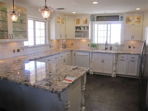 Slate Vs Granite Countertops by Blanco Antico Granite With White Cabinets And Slate Floors