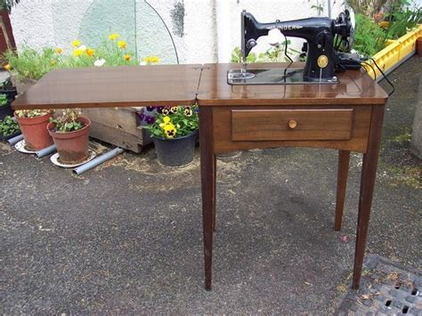 Singer sewing machine in cabinet table, electric, vintage