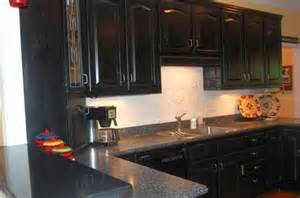 black kitchen cabinets and granite countertops the