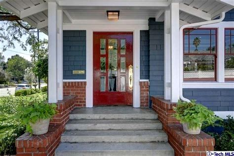 blue house with red door giving an old california craftsman new curb appeal hooked on houses