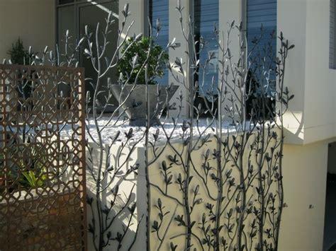 Charmant Mur Anti Bruit Jardin #7: Panneaux-occultants-m%C3%A9talliques-d%C3%A9coration-jardin-moderne.jpg