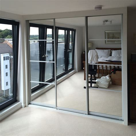 bedroom mirrored wardrobes mirrored wardrobes bring light and space to your bedroom