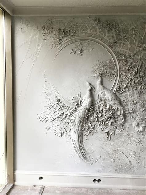 interior bas relief sculptures  peacocks  lush