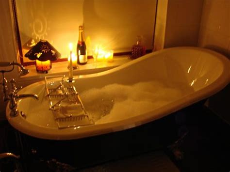 bathtub candles bubble baths bath and candle lit on pinterest