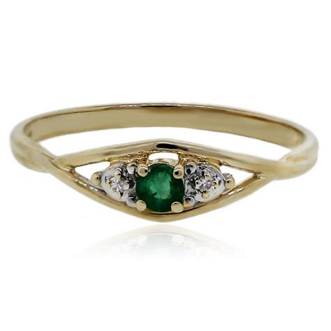 emerald with accents yellow gold ring