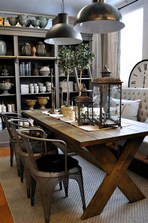 rustic dining room table with bench loving this dining room the rustic table metal chairs