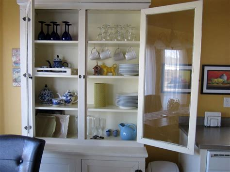 how to turn your cabinet faces to glass what s inside the china cabinet organized styled
