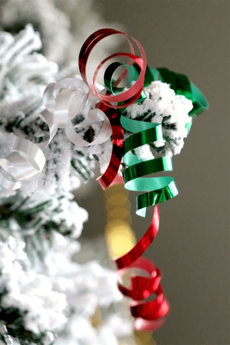decrating a christmas tree with very thincurly ribbon paper clip and ribbon diy ornaments