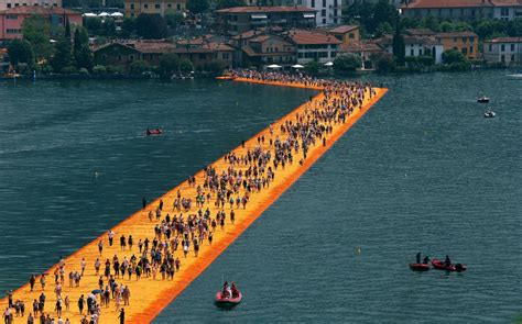 floating piers people walk on water at italian lake floating piers