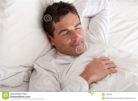 man in bed man sleeping in bed stock images image 19062964