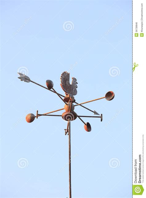 compass house weather vane compass over house roof against blue sky background stock photo image