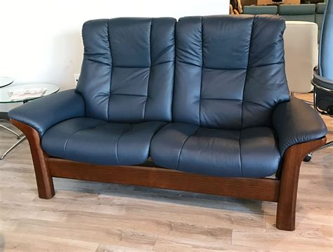 The Stressless High Back Leather stressless buckingham 2 seat high back loveseat oxford blue leather brown walnut wood