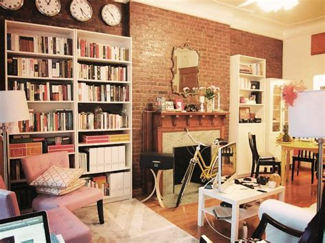 new york apartment ikea white billy bookcases exposed