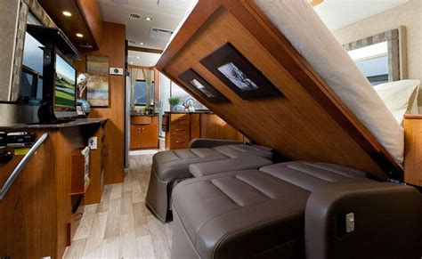 class a motorhome with 2 bedrooms queen size murphy bed coming down in a class a rv rving