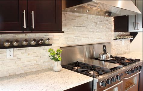 kitchen with stone backsplash creating a kitchen backsplash that attracts buyers