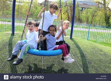 swing in london children playing on a tyre tire swing in a london