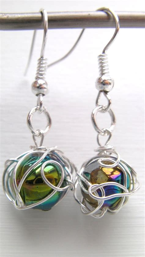 how to wire wrap a bead swirling orb wire wrapped bead earrings by