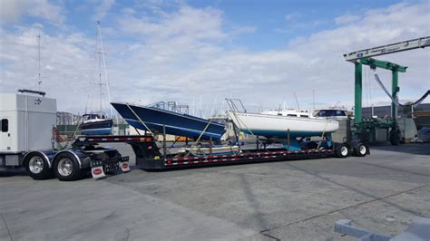 small boat cost transport 3 small boats coast to coast us boat haulers