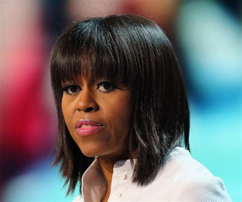 miss obama cuts hair michelle obama medium straight cut with bangs michelle
