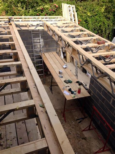 metal web joists forming large opening  flat roof  lob