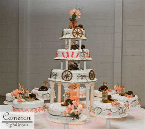 quinceanera western themes country themed cake with cowboy hats boots and wagon