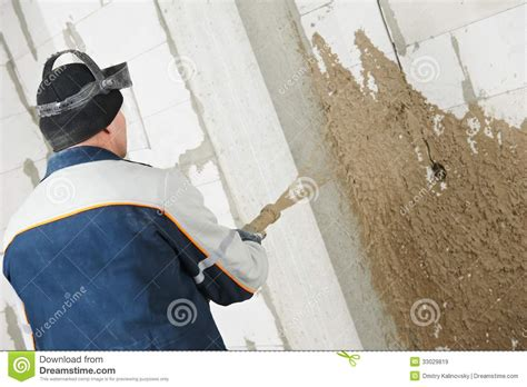 spray painting new plaster plasterer at stucco work with liquid plaster royalty free