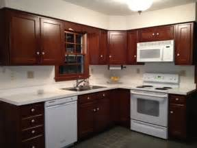 Painting Oak Kitchen Cabinets Before And After Brown Cabinets White Corian Countertop W White Appliances