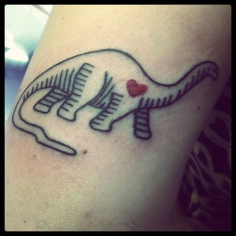small dinosaur tattoos i the i want a neck dinosaur like this