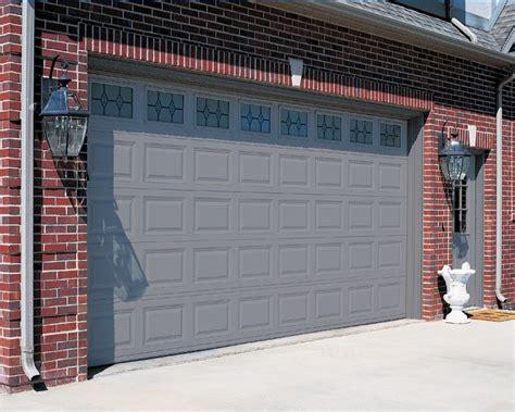 Red Brick House With A Garage Door And Front Door Color Garage Door Colors