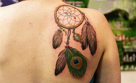 dreamcatcher tattoo with peacock feathers peacock feather dreamcatcher ink pinterest